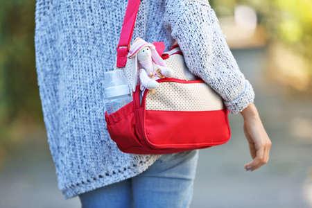 Foto de Woman with baby bag on street - Imagen libre de derechos