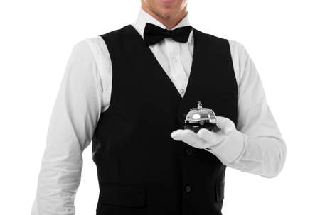 Photo pour Young waiter with service bell on white background - image libre de droit