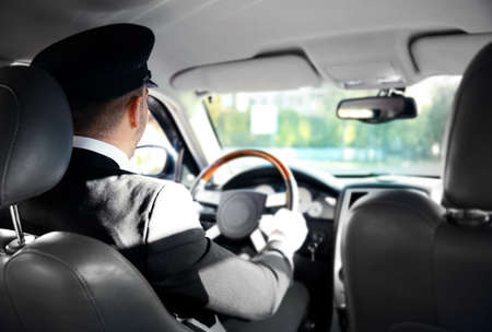 Photo for Chauffeur driving a car, view from inside - Royalty Free Image