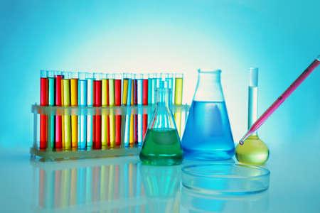 Foto de Chemical test-tubes with medicine dropper on color background - Imagen libre de derechos