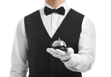 Photo pour Bellboy holding bell on his hand, close up - image libre de droit