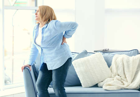 Photo for Senior woman suffering from backache at home - Royalty Free Image