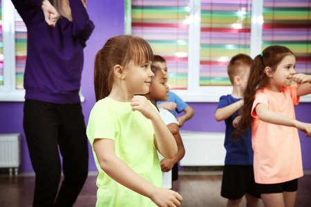 Photo pour Children dancing in choreography class - image libre de droit