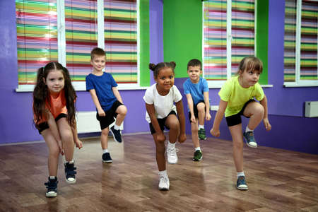 Photo pour Group of children dancing in choreography class - image libre de droit