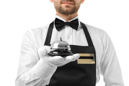 Photo pour Waiter with bell on white background, closeup - image libre de droit
