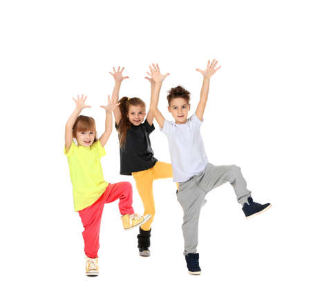 Photo pour Cute funny children dancing on white background - image libre de droit