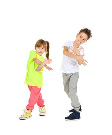 Photo pour Cute funny children dancing on white background - image libre de droit