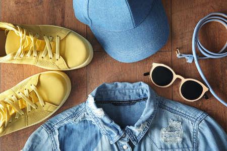 Foto de Stylish clothing on wooden floor - Imagen libre de derechos