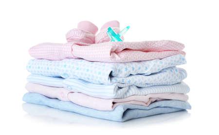 Photo pour Baby shoes, pile of clothes and dummy on white background - image libre de droit