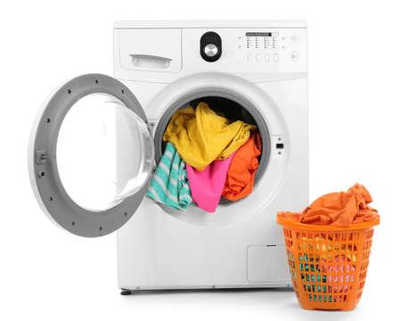Photo pour Clothes in washing machine on white background - image libre de droit