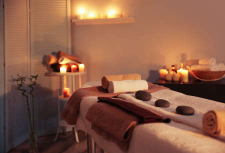 Photo for Interior of modern massage room in candle light - Royalty Free Image