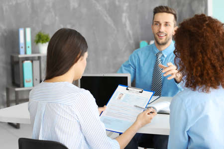 Photo for Job interview concept. Human resources commission interviewing man - Royalty Free Image