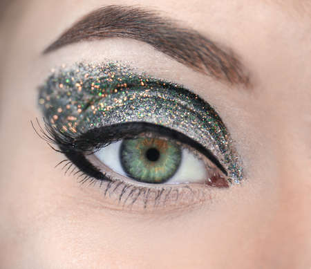 Foto de Female eye with fancy glitter makeup, closeup - Imagen libre de derechos