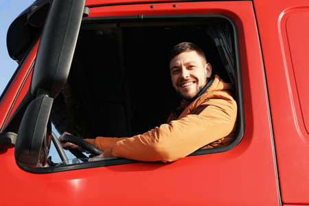 Photo for Male driver looking out of truck window - Royalty Free Image