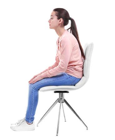Foto de Posture concept. Young woman sitting on chair against white background - Imagen libre de derechos