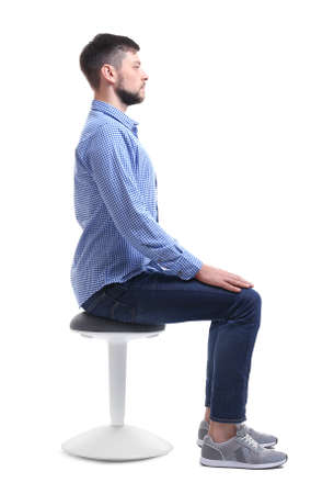 Foto de Posture concept. Man sitting on chair against white background - Imagen libre de derechos
