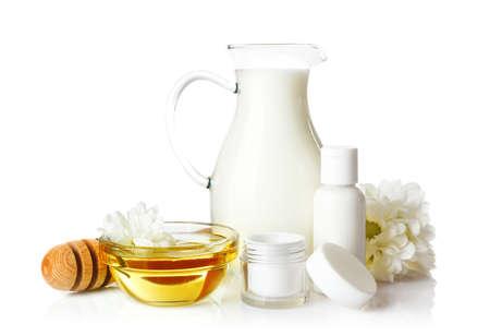 Foto de Honey, milk and cosmetics on white background - Imagen libre de derechos