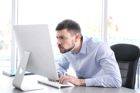 Foto de Posture concept. Man working with computer at office - Imagen libre de derechos