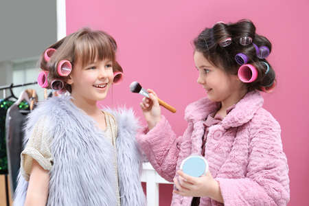 Photo pour Cute little girls playing with their mother's stuff at home - image libre de droit