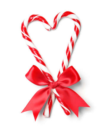 Photo for Heart shape made with candy canes on white background - Royalty Free Image