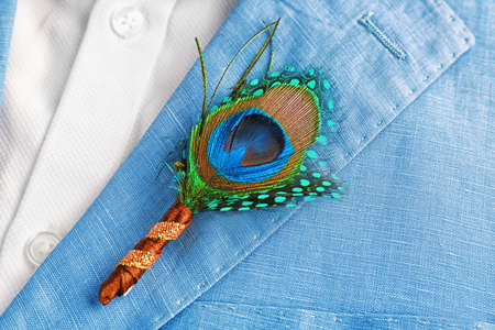 Photo for Beautiful boutonniere with feather on suit for groom, closeup - Royalty Free Image