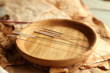 Photo for Acupuncture needles on wooden table - Royalty Free Image
