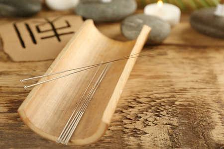 Photo pour Acupuncture needles on wooden table - image libre de droit