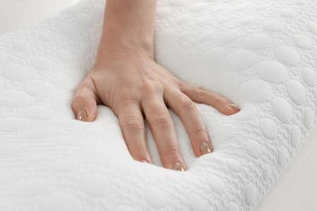 Photo pour Female hand on orthopedic pillow, closeup - image libre de droit