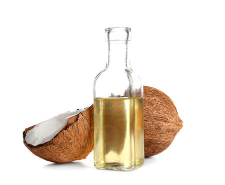 Photo for Bottle with melted coconut oil and nut on white background - Royalty Free Image