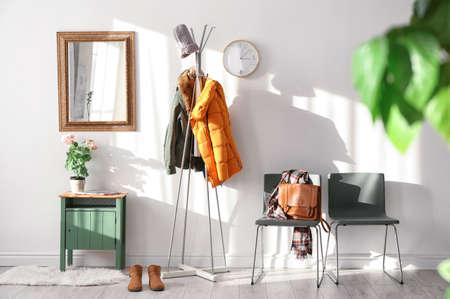 Foto für Modern hall interior with hanging clothes - Lizenzfreies Bild