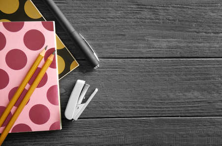 Photo pour Notebooks and different stationery on wooden background - image libre de droit