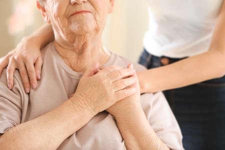 Foto de Young girl hugging old woman, closeup - Imagen libre de derechos