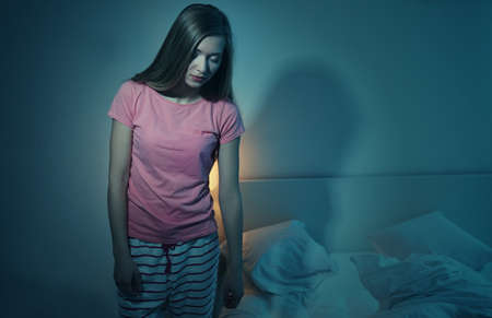 Photo pour Young sleepy woman suffering from somnambulism at home - image libre de droit