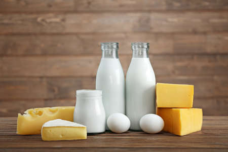 Photo for Different dairy products on wooden table - Royalty Free Image
