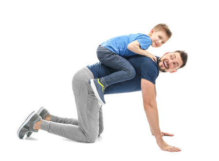 Photo for Handsome man playing with his son on white background - Royalty Free Image