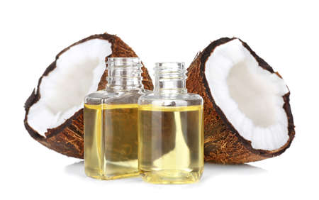 Photo for Perfume bottles and coconut on white background - Royalty Free Image