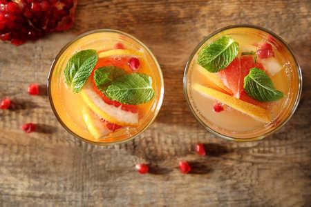 Foto de Two glasses of fresh citrus cocktail on table - Imagen libre de derechos