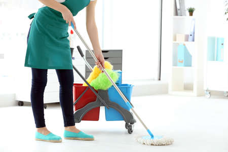 Photo for Woman washing floor in office. Cleaning service concept - Royalty Free Image