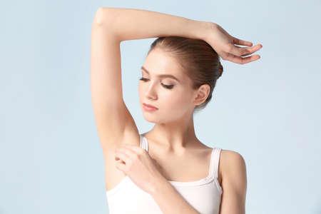 Photo pour Beautiful young woman on color background. Epilation concept - image libre de droit