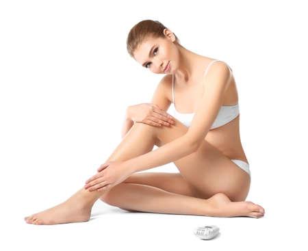 Photo pour Beautiful young woman with epilator on white background - image libre de droit