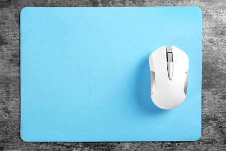 Photo for Blank mat and wireless mouse on textured background - Royalty Free Image