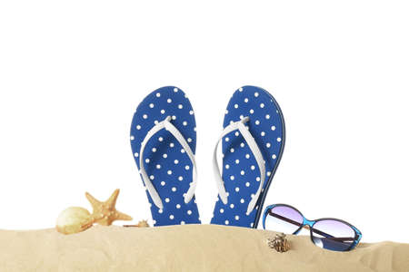 Photo for Flip-flops and sunglasses on sand against white background. Summer vacation concept - Royalty Free Image