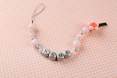 Photo for Beautiful pacifier clip with place for baby name on table - Royalty Free Image