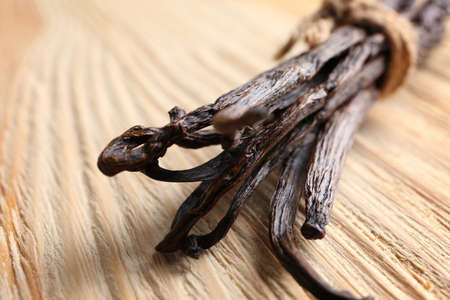 Photo for Dried vanilla sticks on wooden background, closeup - Royalty Free Image