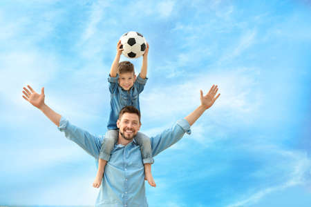 Foto de Dad and son with soccer ball outdoors - Imagen libre de derechos