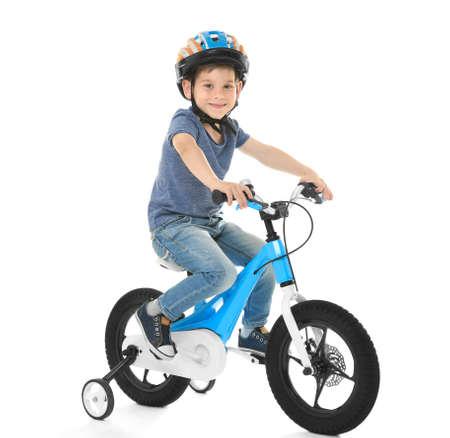 Photo pour Cute little boy riding bicycle on white background - image libre de droit