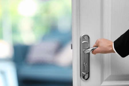 Photo for Person opening door of hotel room - Royalty Free Image