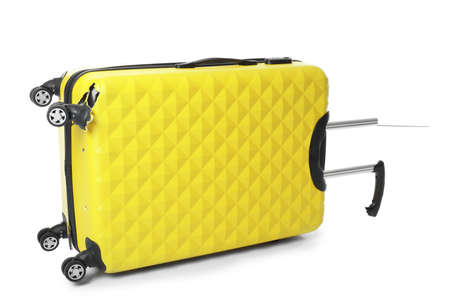 Photo pour Yellow plastic luggage with broken handle and wheel isolated on white - image libre de droit