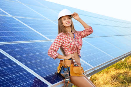 Photo pour Beautiful young engineer near solar panels outdoors - image libre de droit