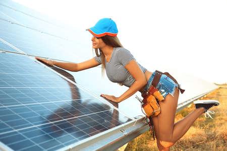 Foto de Beautiful young engineer near solar panels outdoors - Imagen libre de derechos